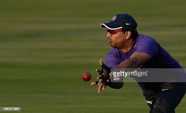 Indian cricketer Yuvraj Singh catches a ball during a training session at The Sardar Patel Stadium at Motera in Ahmedabad on November 12 2012 India...