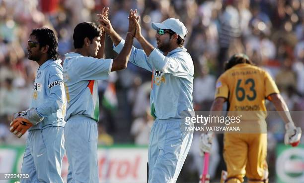 Indian cricketer Yuvraj Singh congratulates teammate Rudra Pratap Singh for taking the wicket of Australian Andrew Symonds during the fourth OneDay...