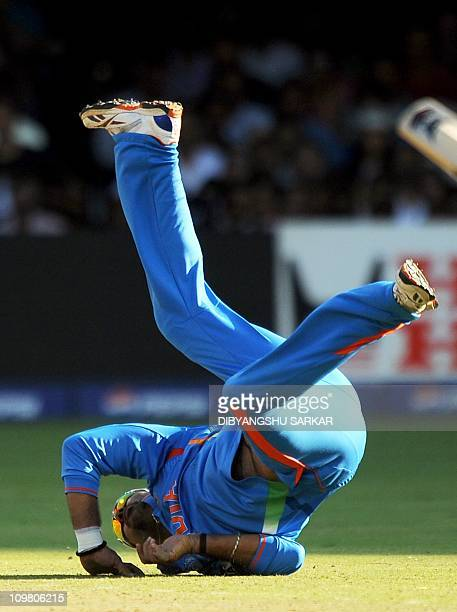 Indian cricketer Yuvraj Singh dives to attempt a catch off his own bowling during the Cricket World Cup 2011 match between India and Ireland at The M...