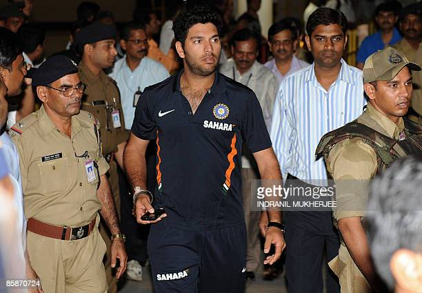 Indian cricketer Yuvraj Singh walks out of the city airport after arriving from New Zealand in Mumbai late April 8 2009 The Indian cricket team being...