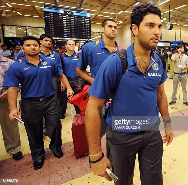Indian cricketer Yuvraj Singh walks with his teammates upon their arrival at the Jinnah International airport in KarachiPakistan on June 23 2008...
