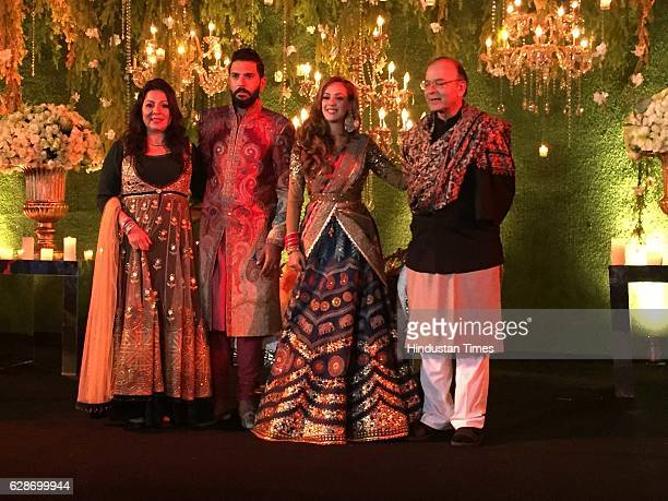 Indian Cricketer Yuvraj Singh with Bollywood actor Hazel Keech and Finance Minister Arun Jaitley during their wedding reception at ITC Maurya on...