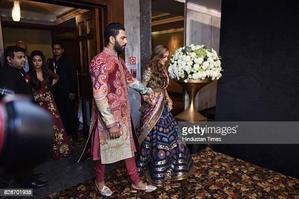Indian Cricketer Yuvraj Singh with Bollywood actor Hazel Keech during their wedding reception at ITC Maurya on December 7 2016 in New Delhi India