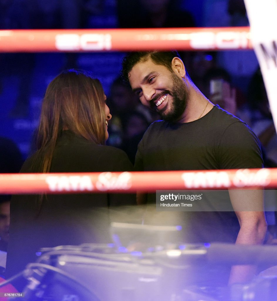 Indian Cricketer Yuvraj Singh with Bollywood actress Neha Dhupia witnessing the bouts of Indian professional boxer Vijender Singh and Kerry Hope of...