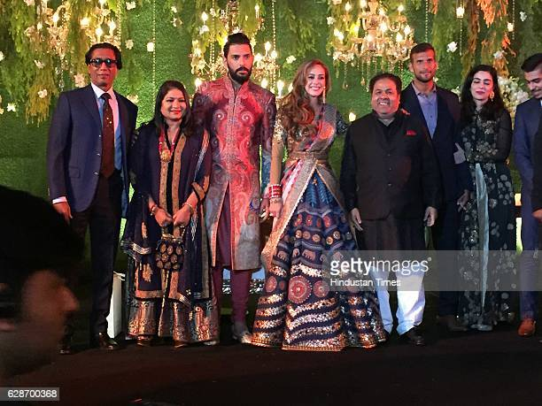 Indian Cricketer Yuvraj Singh with his wife and Bollywood actor Hazel Keech and IPL Chairman Rajiv Shukla with wife Anuradha Prasad during their...