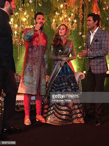 Indian Cricketer Yuvraj Singh with his wife and Bollywood actor Hazel Keech and Cricketer Mohammad Kaif during their wedding reception at ITC Maurya...