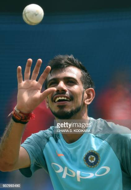 Indian cricketer Yuzvendra Chahal catches the ball during a practice session at the RPremadasa Stadium in Colombo on March 17 2018 India is playing...