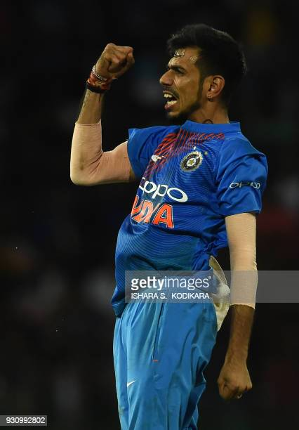 Indian cricketer Yuzvendra Chahal celebrates after dismissing Sri Lankan batsman Kusal Mendis during the fourth Twenty20 international cricket match...