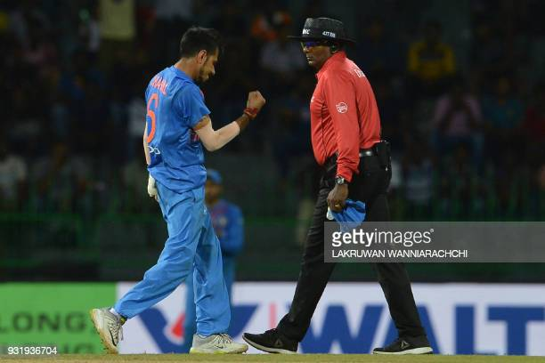 Indian cricketer Yuzvendra Chahal celebrates after he dismissed Bangladesh cricket captain Mahmudullah during the Fifth Match Nidahas Twenty20...