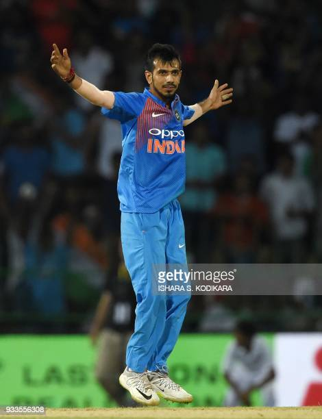 Indian cricketer Yuzvendra Chahal celebrates after he dismissed Bangladesh cricketer Tamim Iqbal during the final Twenty20 international cricket...