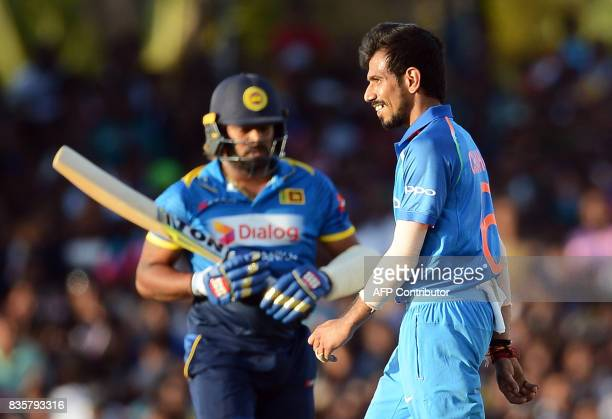 Indian cricketer Yuzvendra Chahal celebrates after he dismissed Sri Lankan cricketer Lasith Malinga during the first One Day International cricket...