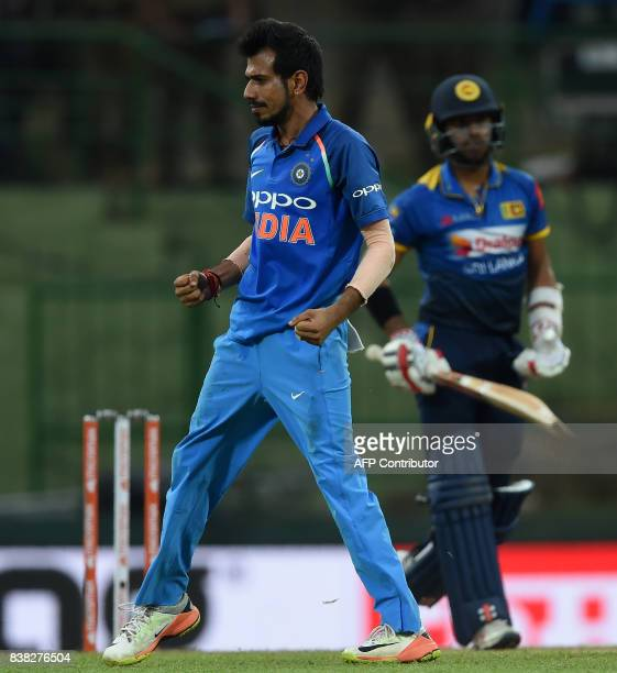 Indian cricketer Yuzvendra Chahal celebrates after he dismissed Sri Lankan cricketer Kusal Mendis during the second one day international cricket...