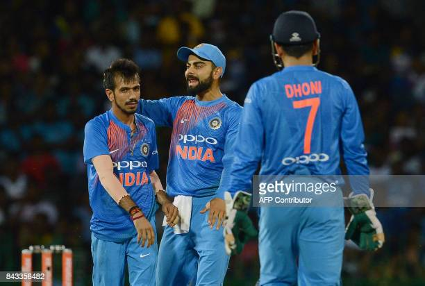 Indian cricketer Yuzvendra Chahal celebrates after he dismissed Sri Lankan cricketer Dasun Shanaka during the Twenty20 international cricket match...