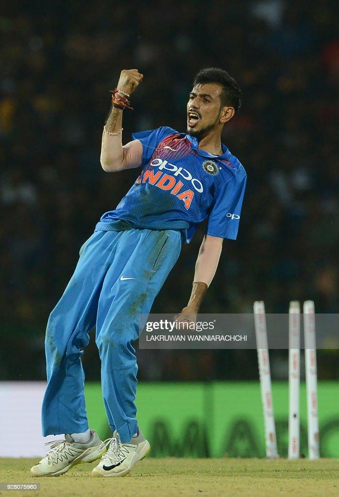 Indian cricketer Yuzvendra Chahal celebrates after he dismissed Sri Lankan batsman Upul Tharanga during the opening Twenty20 international cricket match between Sri Lanka and India for the Nidahas Trophy tri-nation Twenty20 tournament at The R. Premadasa Stadium in Colombo on March 6, 2018. The Nidahas Trophy tri-nation Twenty20 tournament involving Sri Lanka, Bangladesh and India. /