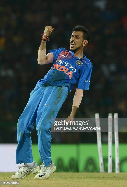 Indian cricketer Yuzvendra Chahal celebrates after he dismissed Sri Lankan batsman Upul Tharanga during the opening Twenty20 international cricket...