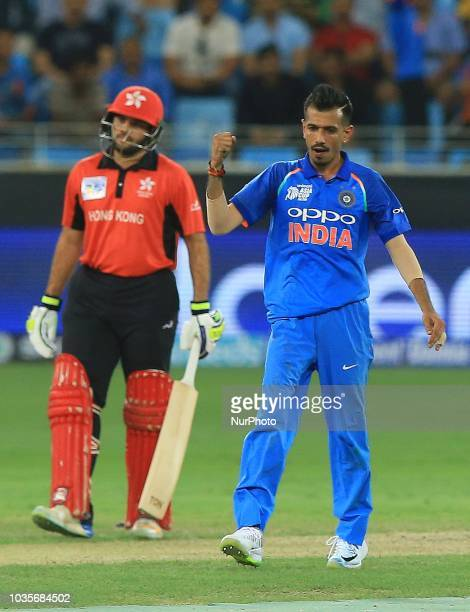 Indian cricketer Yuzvendra Chahal celebrates after taking a wicket during the 4th cricket match of Asia Cup 2018 between India and Hong Kong at Dubai...