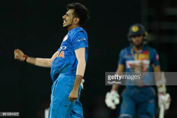 Indian cricketer Yuzvendra Chahal celebrates after taking a wicket during the 4th Twenty20 cricket match of NIDAHAS Trophy between Sri Lanka and...
