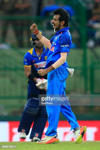 Indian cricketer Yuzvendra Chahal celebrates after taking the wicket of Sri Lanka's Kusal Mendis during the 2nd One Day International cricket match...