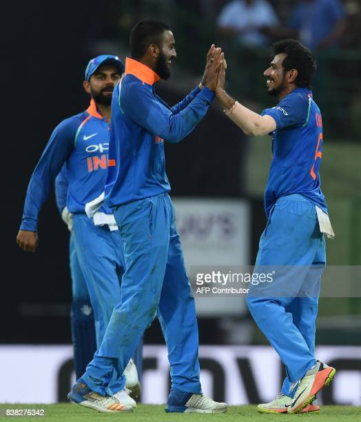 Indian cricketer Yuzvendra Chahal celebrates with his teammates after he dismissed Sri Lankan cricketer Kusal Mendis during the second one day...