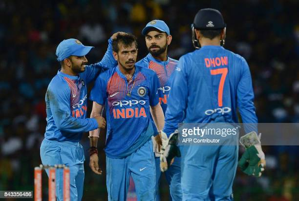 Indian cricketer Yuzvendra Chahal celebrates with his teammates after he dismissed Sri Lankan cricketer Dasun Shanaka during the Twenty20...