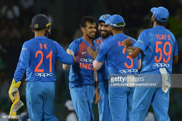 Indian cricketer Yuzvendra Chahal celebrates with his teammates after he dismissed Bangladesh cricket captain Mahmudullah during the Fifth Match...