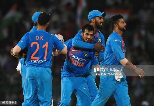 Indian cricketer Yuzvendra Chahal celebrates with his teammates after he dismissed Bangladeshi cricketer Soumya Sarkar during the final Twenty20...
