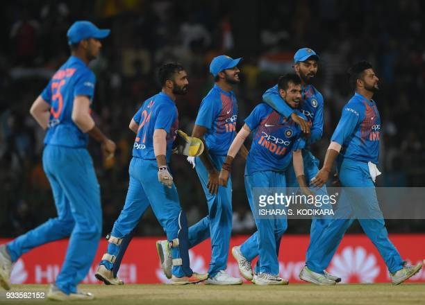 Indian cricketer Yuzvendra Chahal celebrates with teammates after he dismissed Bangladeshi cricketer Soumya Sarkar during the final Twenty20...