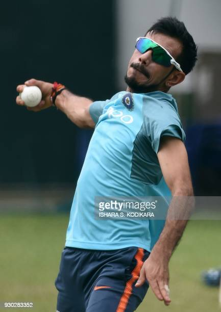 Indian cricketer Yuzvendra Chahal delivers the ball at a training session at the R Premadasa Stadium in Colombo on March 11 2018 The Nidahas Trophy...