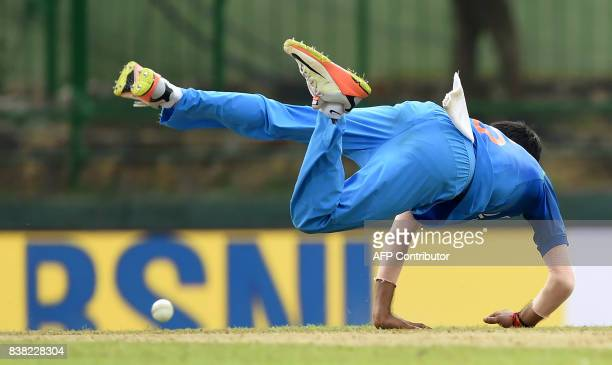 Indian cricketer Yuzvendra Chahal dives to field the ball during the second one day international cricket match between Sri Lanka and India at the...