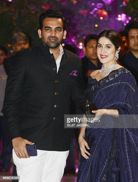 Indian Cricketer Zaheer Khan poses for a picture with his wife and actress Sagarika Ghatge as they attend the preengagement party of India's richest...