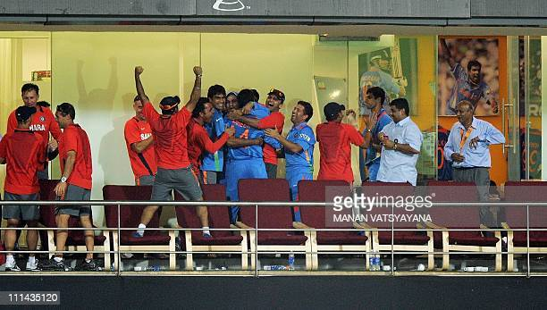 Indian cricketers and coaching staff celebrate after beating Sri Lanka during the ICC Cricket World Cup 2011 final match at The Wankhede Stadium in...