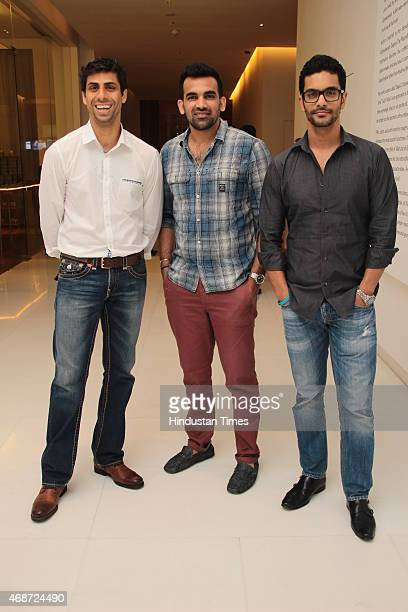Indian cricketers Ashish Nehra and Zaheer Khan with actor Angad Bedi during the launch of Vivanta by Taj Dwarka New Delhi on April 1 2015 New Delhi...