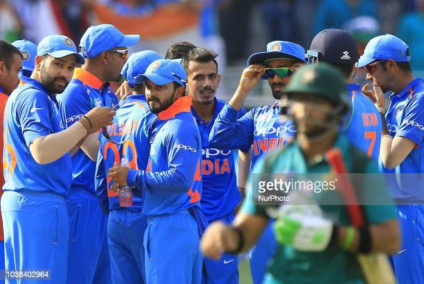 Indian cricketers celebrate after taking a wicket during the Asia Cup 2018 cricket match between India and Pakistan at Dubai International cricket...
