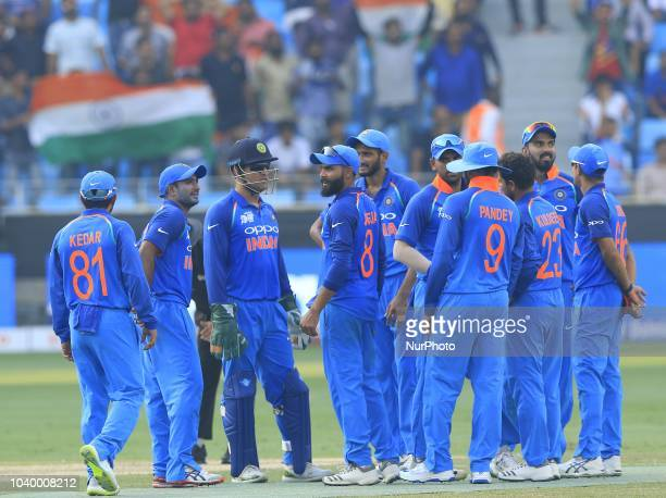 Indian cricketers celebrate after taking a wicket during the Asia Cup 2018 cricket match between India and Afghanistan at Dubai International cricket...