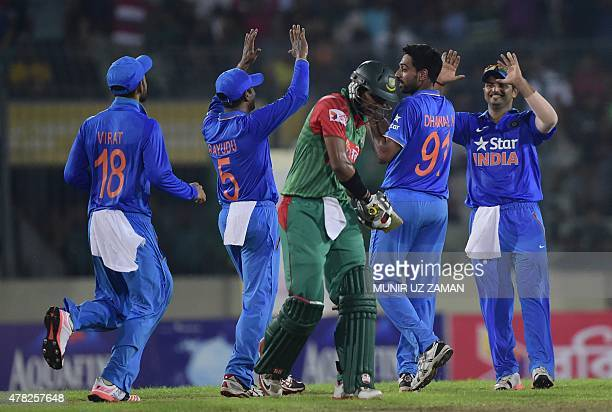 Indian cricketers celebrate after the dismissal of Bangladesh cricketer Soumya Sarkar during the third ODI cricket match between Bangladesh and India...