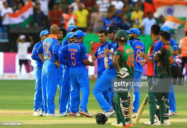 Indian cricketers celebrate during the final cricket match of Asia Cup 2018 between India and Bangladesh at Dubai International cricket...