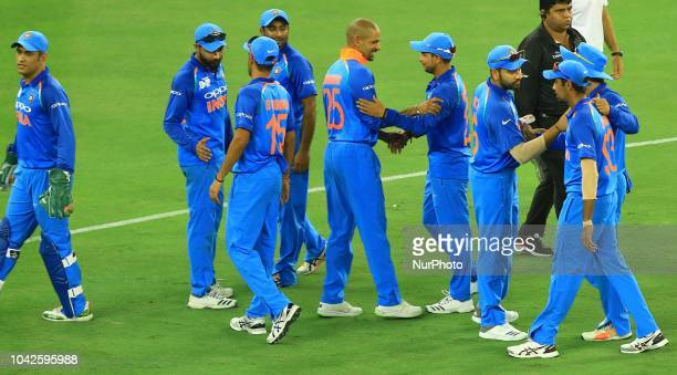 Indian cricketers celebrate during the final cricket match of Asia Cup 2018 between India and Bangladesh at Dubai International cricket stadiumDubai...