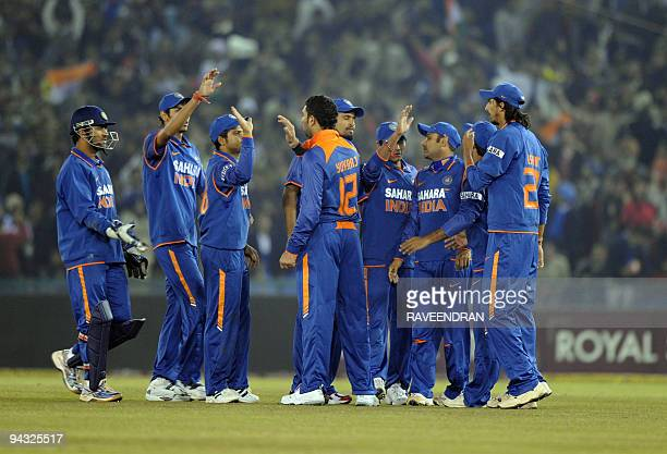 Indian cricketers celebrate the wicket of Sri Lankan batsman Tillakaraine Dilshan during the second Twenty20 International match between India and...