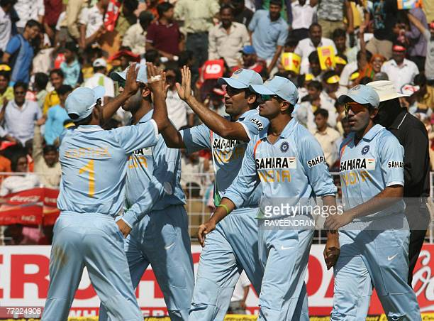 Indian cricketers celebrate their victory over Australia after the fourth OneDay International match in Chandigarh 08 October 2007 India won the...
