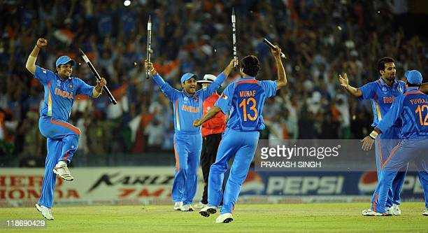 Indian cricketers celebrate victory over Pakistan during the ICC Cricket World Cup 2011 semifinal match between India and Pakistan at The Punjab...