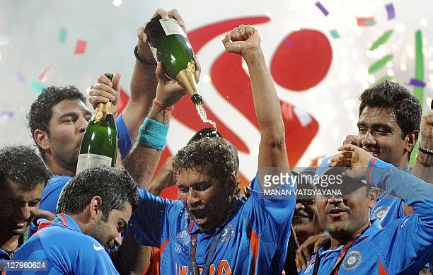 Indian cricketers celebrate with champagne after beating Sri Lanka in the ICC Cricket World Cup 2011 final match at The Wankhede Stadium in Mumbai on...