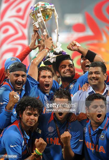 Indian cricketers celebrate with the trophy after beating Sri Lanka in the ICC Cricket World Cup 2011 final match at The Wankhede Stadium in Mumbai...