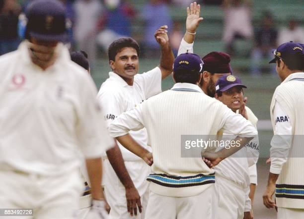 Indian cricketers congratulate Javagal Srinath for taking the wicket of Marcus Trescothik on the first day of the third and final Test between India...