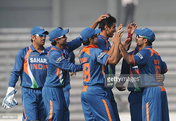 Indian cricketers congratulate teammate Sudeep Tyagi during the TriNation tournament One Day International cricket match at The Shere Bangla National...