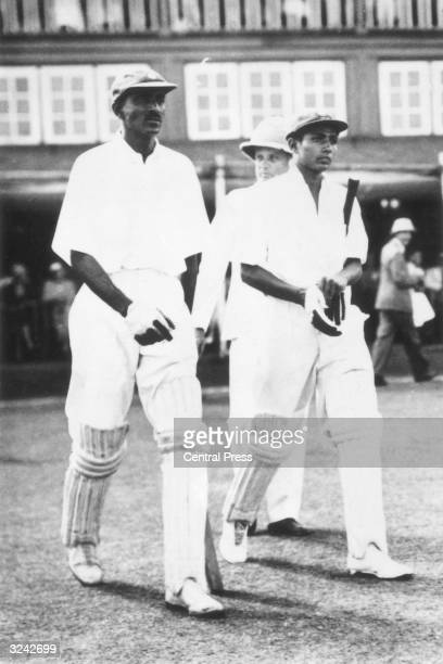 Indian cricketers Cottari Kanakaiya Nayudu left and Nanik Amarnath Bharadwaj coming out to bat during the First Test Match against England in Bombay