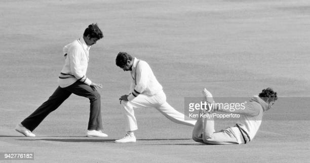 Indian cricketers Dilip Vengsarkar Anshuman Gaekwad and Mohinder Amarnath warm up with some stretching exercises before the final day's play of the...