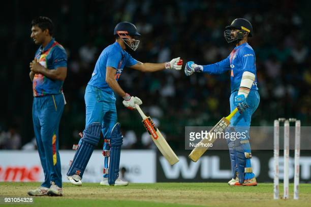 Indian cricketers Dinesh Karthik and Manish Pandey congratulate each other after winning the 4th Twenty20 cricket match of NIDAHAS Trophy between Sri...