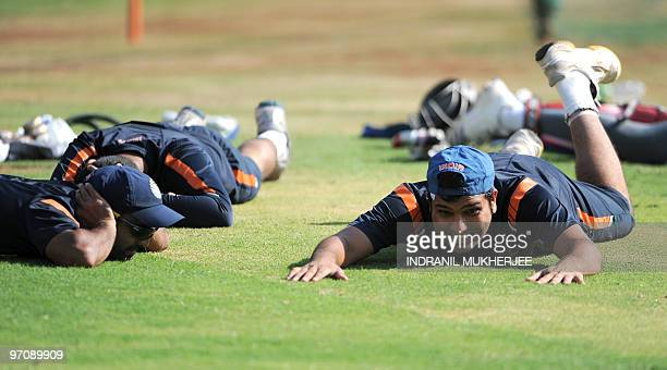Indian cricketers Dinesh Karthik and Rohit Sharma take evasive action from a passing swarm of bees during a training session on the eve of the third...