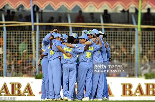 Indian cricketers form a huddle as they celebrate the dismissal of Bangladeshi captain Habibul Bashar during the first One Day International match...