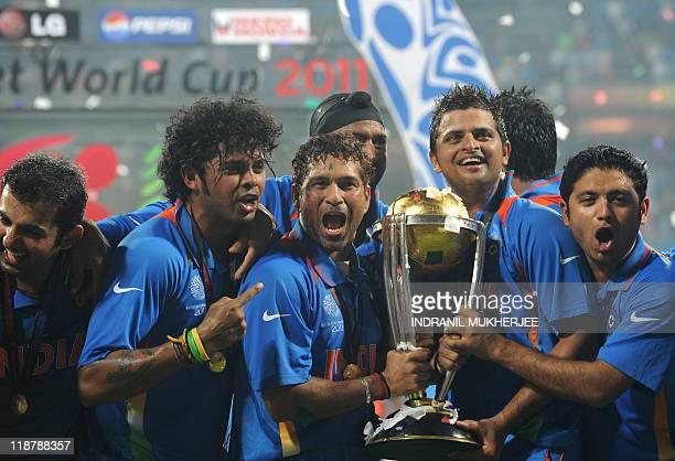 Gautam Gambhir Shanthakumaran Sreesanth Sachin Tendulkar Harbhajan Singh Suresh Raina and Piyush Chawla celebrate with the trophy after victory in...